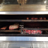 The inside of a PIra charcoal oven 120 ED
