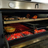 Inside of a PIRA Charcoal Oven 120 LUX INOX.