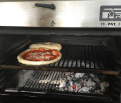 Pizza cooking with a PIRA 70 Lux charcoal oven