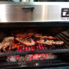 Use PIRA 70 XL LUX charcoal ovens to give the flavor of charcoal to the seafood.