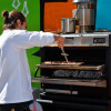 Chef cooking rice in a PIRA charcoal oven 70 XL LUX.