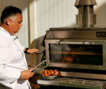 The lifting door of the PIRA 80 ED charcoal oven offers comfort and vision to the chef.