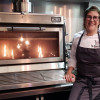 Rakel Cernicharo, top chef winner, happy with the spectacularity that only a PIRA charcoal Oven can offer.