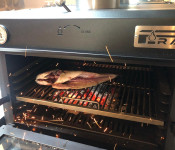 Detail Fish Cooking inside Pira 70 Black Charcoal Oven